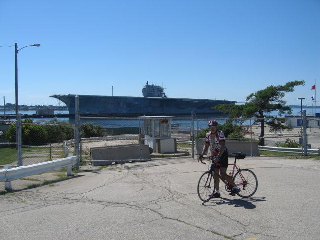 Charlie w USS Saratoga in background